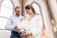 Parents with baby at christening in church